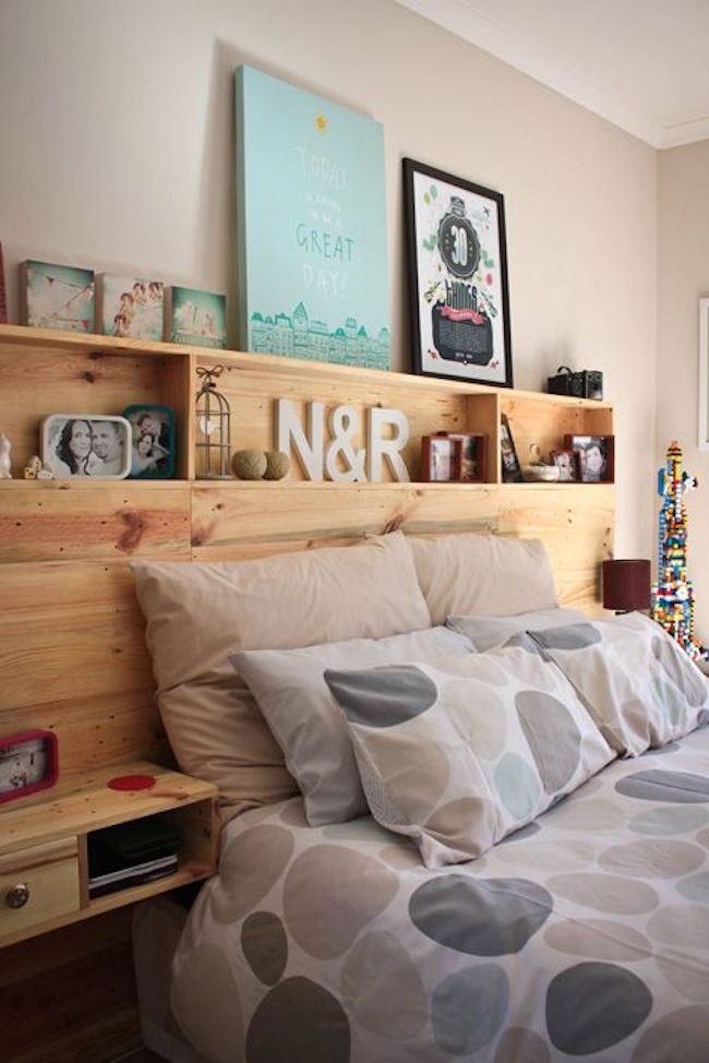 Custom pallet headboard with built-in side tables