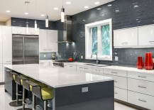 Dark and glossy backsplash in the kitchen with white and gray cabinets [Design: BUILD / Amber Frederiksen Photography]