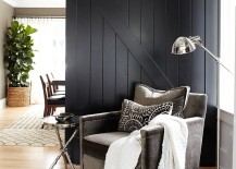 Dark black barn door fits in with the contemporary theme of the living room seamlessly