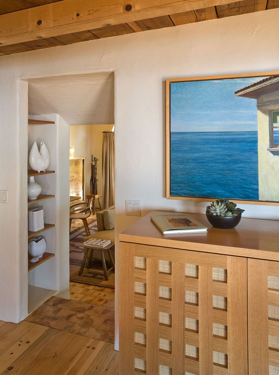 Decor and wall art add a subtle coastal touch to the interior