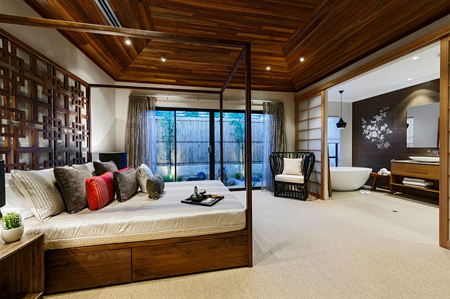 Design of the bathroom adds to the aura of the serene master bedroom