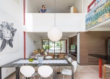 Double height dining area becomes the main social zone in the house