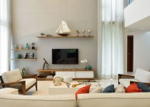 Double-height-living-room-with-a-breezy-ambiance-217x155