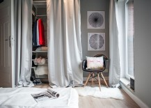 Drapes conceal the simple open closet in the bedroom