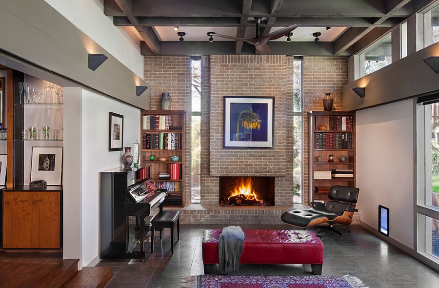 Eames lounger next to the cozy fireplace creates a lovely reading nook [Design: Steinbomer, Bramwell & Vrazel Architects]