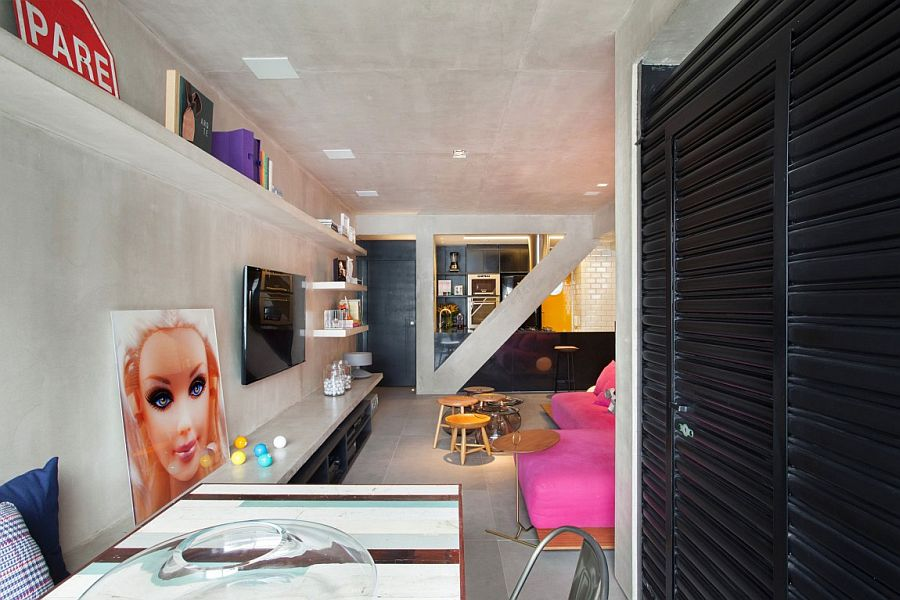 Eclectic decor and a sleek concrete bench in the living room