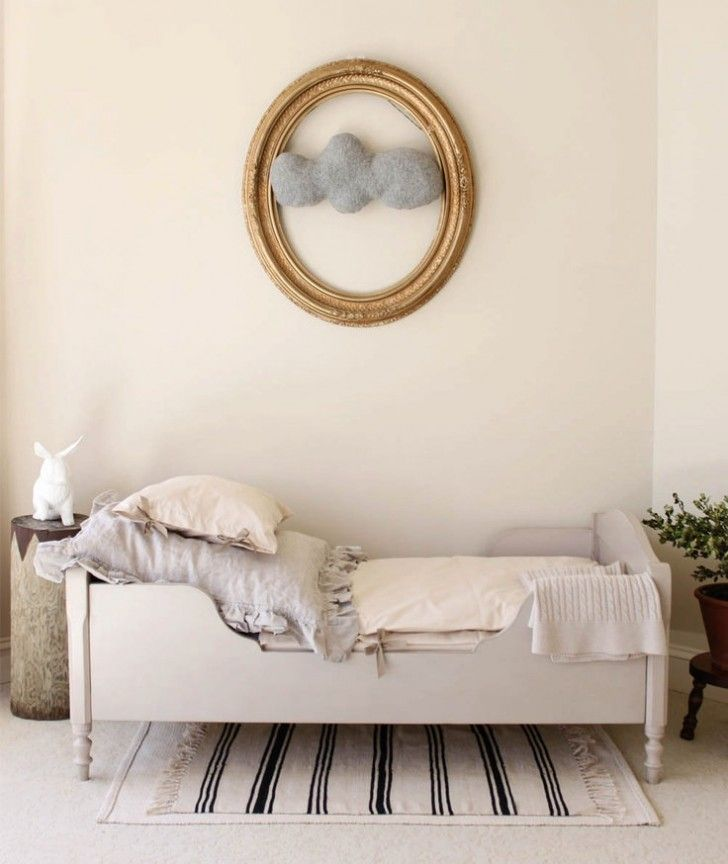 Elegant kids' bedroom with cloud wall art piece
