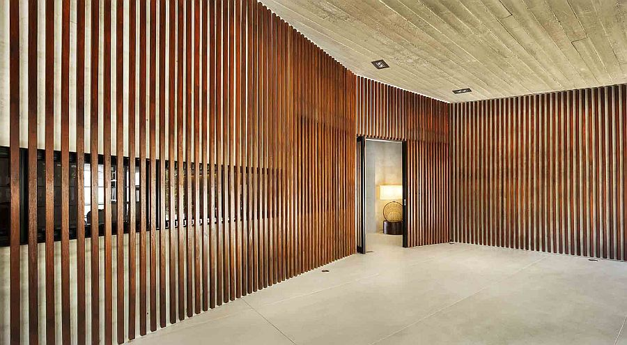 Entry of the home clad in wooden slats