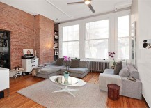 Exposed-brick-wall-with-blackened-steel-book-shelves-in-the-modern-family-room-217x155