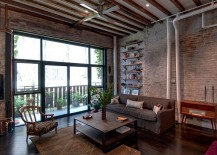 Exposed duct pipes and lovely brick walls are a staple in the industrial living room [Design: Reiko Feng Shui Design]