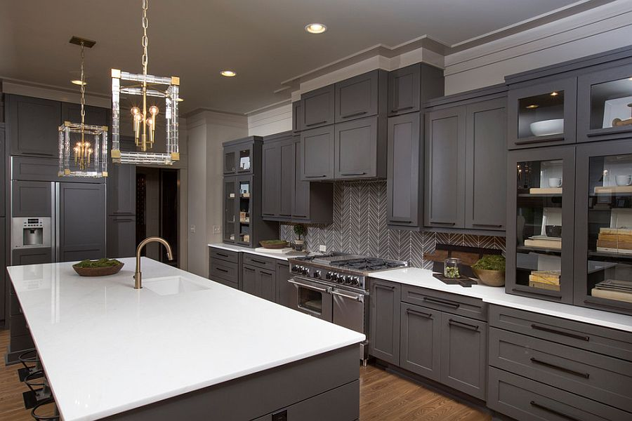 Exquisite gray kitchen with sparkling pendant lighting [Design: Romanelli & Hughes Custom Home Builders]