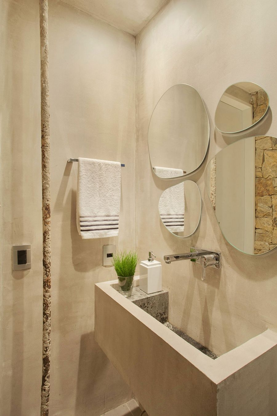 Fabulous collection of mirrors above the bathroom vanity