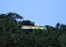 Fabulous futuristic home nestled among green canopy and overlooking Port Douglas in Queensland