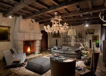 Fabulous-living-area-with-classic-chandelier-lovely-fireplace-and-walls-and-ceiling-with-a-weatherd-finish-217x155