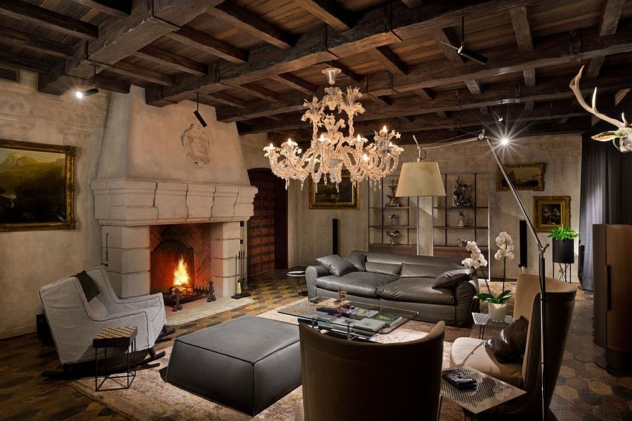 Fabulous living area with classic chandelier, lovely fireplace and walls and ceiling with a weatherd finish