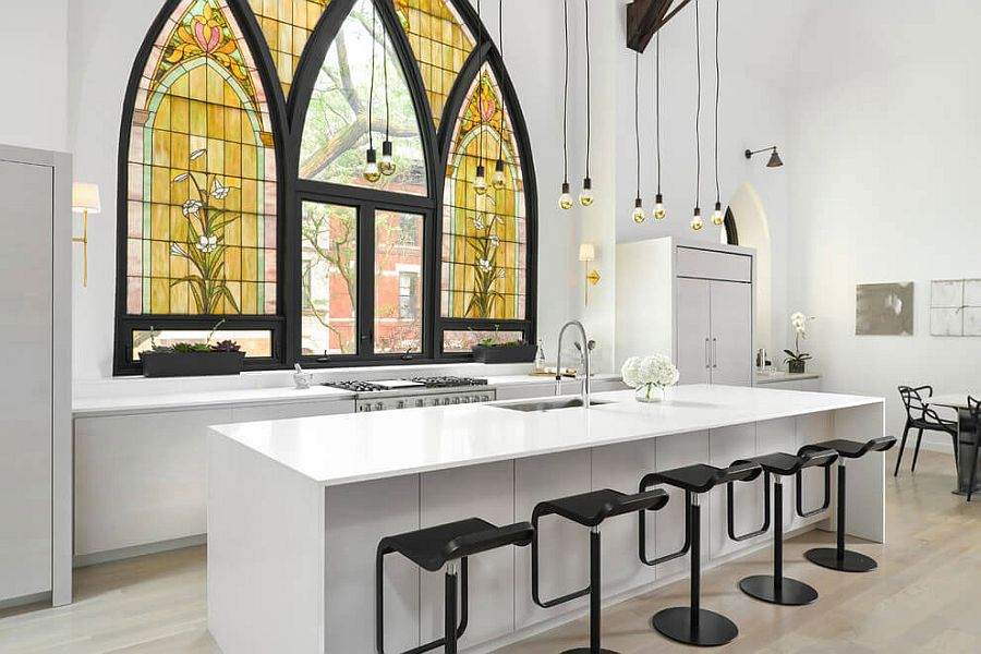 Fabulous modern kitchen in gray, white and black with beautiful stained glass church windows