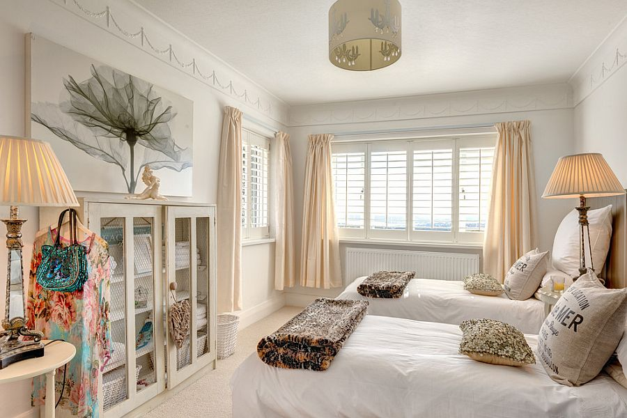 Fabulous use of pastel hues, chicken wire door cabinets and art work in the shabby chic bedroom