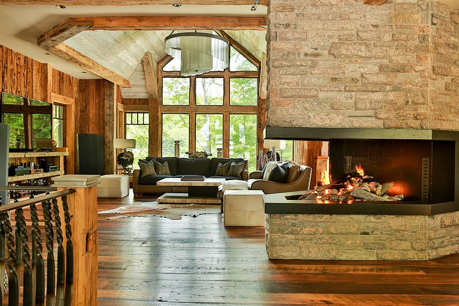 Family room with fireplace offers wonderful views of the lake and beyond
