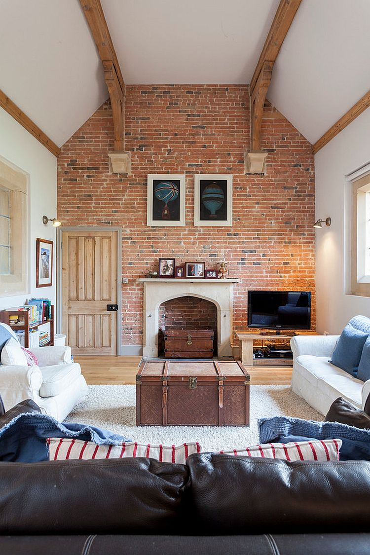 Farmhouse style living room with high ceiling and accent brick wall [Photography: Chris Snook]