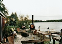 Fireplace and lighting give the lakeside deck a surreal appeal 217x155 25 Awesome Rustic Decks That Offer a Tranquil Escape