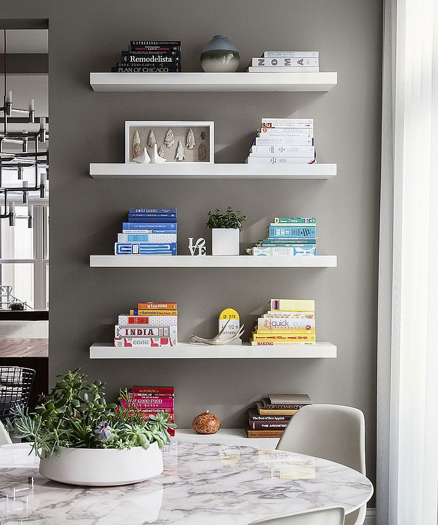 Floating white shelves in the dining room add grace and minimalist style