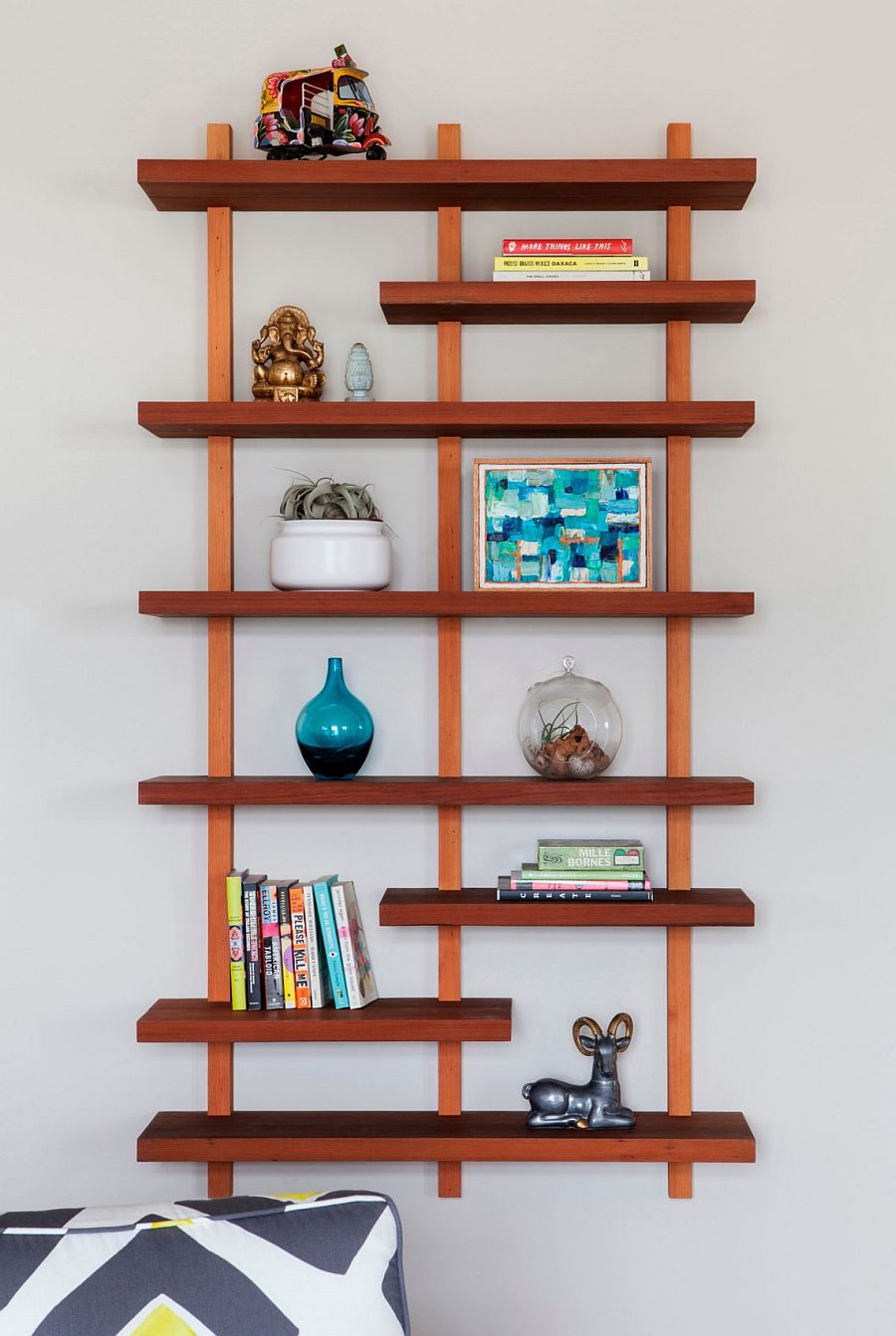 Floating wooden shelf keeps things simple and minimal