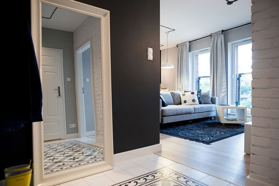 Floor tiles and rug in the living room bring pattern to the interior