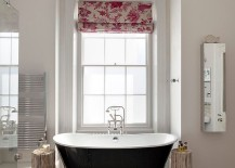 Floor tiles in black and white, floral patterned blind and cool bathtub for the bathroom
