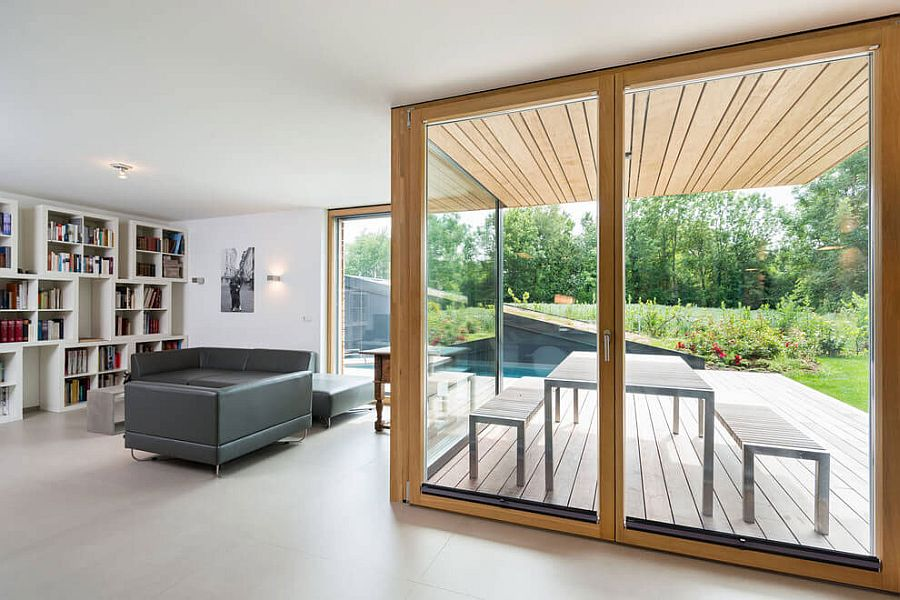 Frame glass doors lead the way from the living room to the backyard