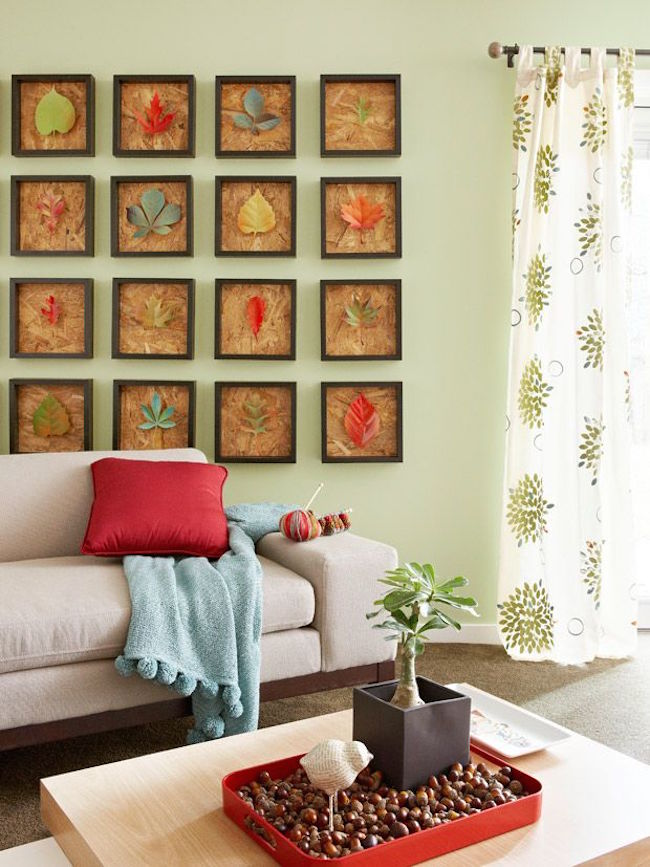 Framed leaves make a statement on a living room wall