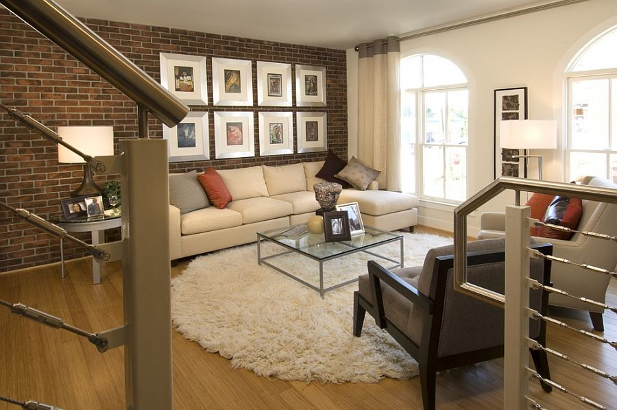 Gallery wall in the living room with exposed brick wall [Design: Carlyn and Company Interiors + Design]