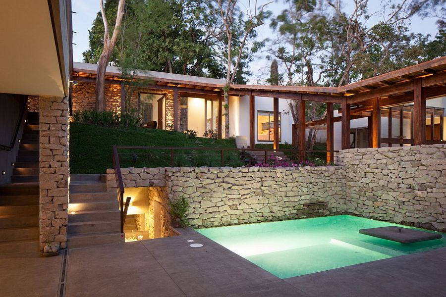 Garden and pool area is visually connected with every room of the lovely home