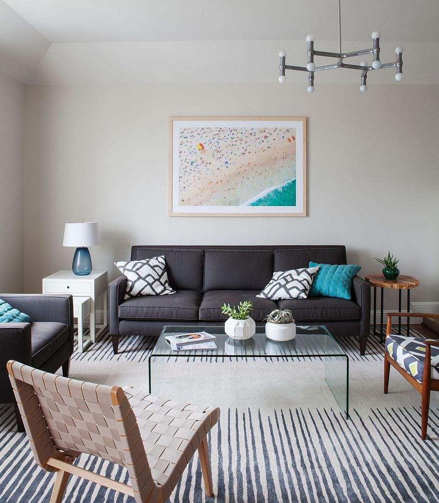 Geo vase, acrylic coffe table, mismatched side tables and lovely wall art for the living room