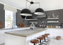 Giant chandelier above the kitchen counter steals the spotlight here