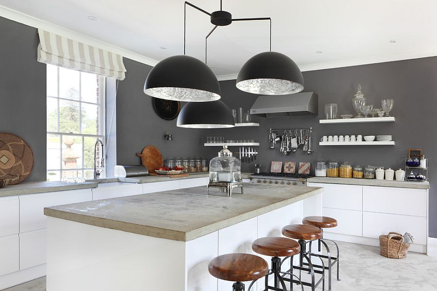 Giant chandelier above the kitchen counter steals the spotlight here [Design: VSP Interiors]