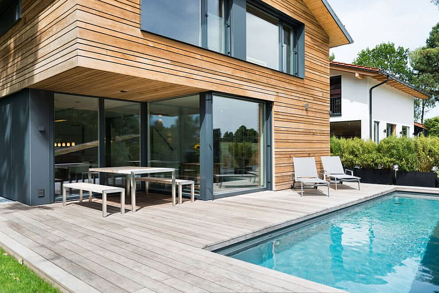 Beautiful Glass Doors Connect The Living Area With The Wooden Deck And Pool Outside
