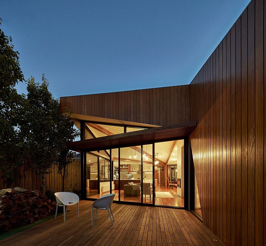 Glass walls and timber deck give the Aussie home a modern vibe