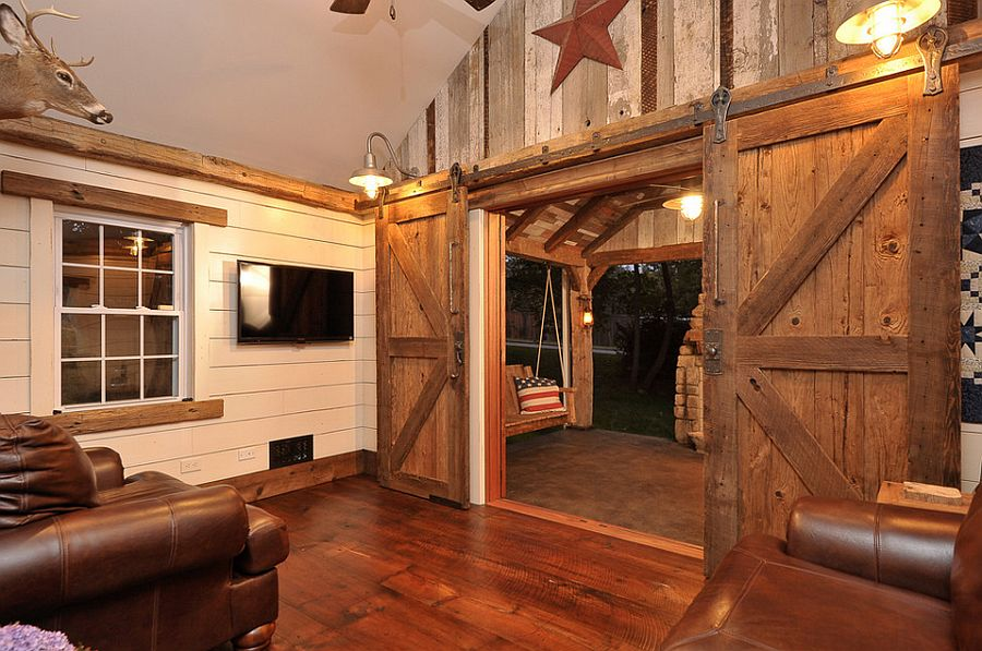 traditional living room with sliding barn door design synthesis design