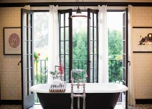 Gorgeous bathroom with black bathtub and vintage charm