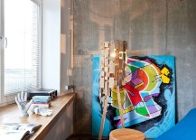Gorgeous floor lamp and colorful art work add character to the interior