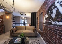 Graffiti on the walls makes for a great addition in the living room with brick walls