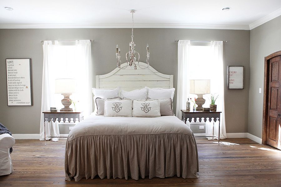 Gray and white create a relaxed ambiance in the bedroom [Design: Magnolia Homes]