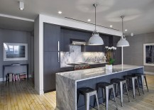 Gray with bluish tinge gives the kitchen a more vibrant tinge