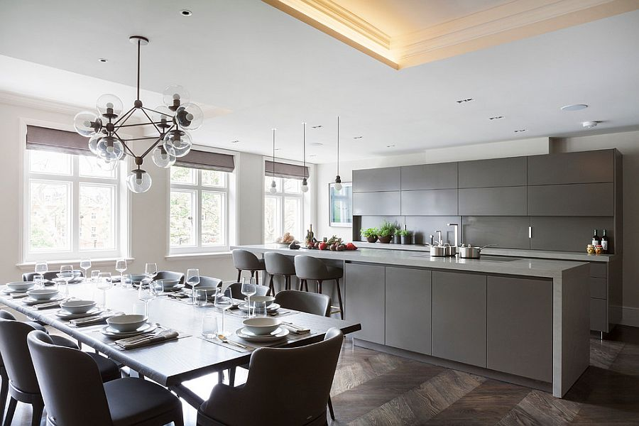 Grey kitchen cabinets and island bring refinement to the contemporary home [Design: Eggersmann London]