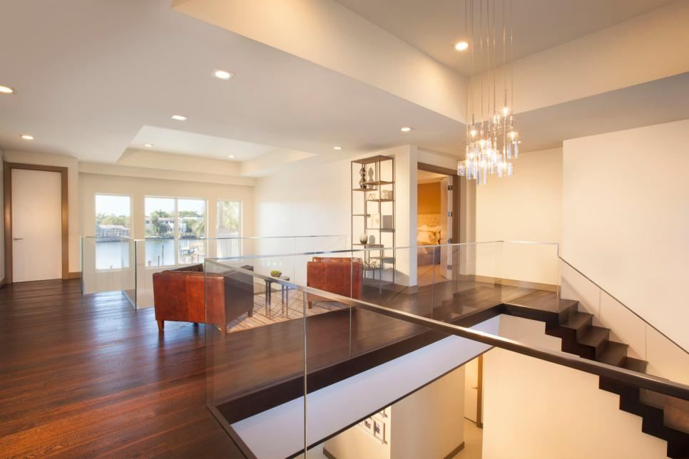 View in gallery hallway with dramatic pendant lighting