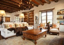 Heavy-wooden-beams-and-brick-walls-accentuate-the-Southwestern-style-in-the-room-217x155