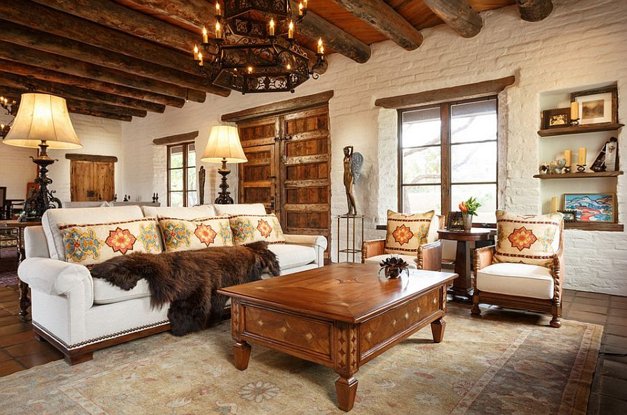 heavy wooden beams and brick walls accentuate the southwestern style in the room design - All About Interior Designing