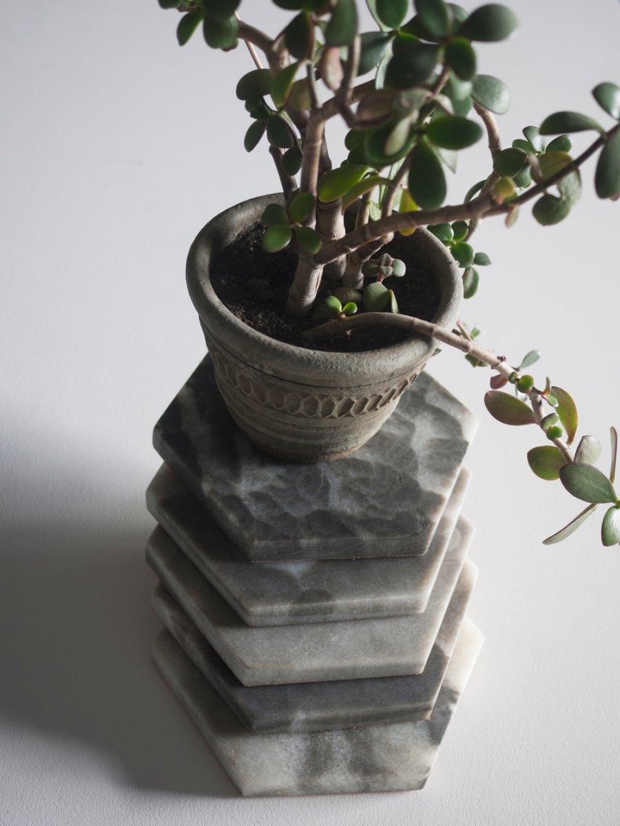 Hexagonal marble trivets from Fort Standard