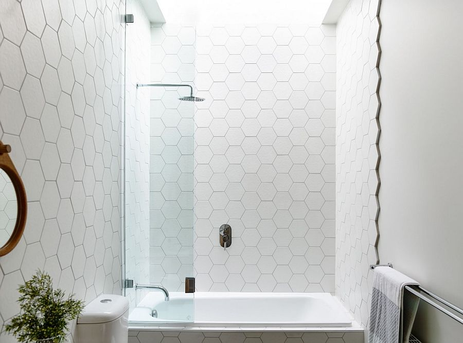 Hexagonal tiles add pattern to the bathroom in white