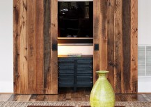 Hide the living room TV behind custom sliding barn doors
